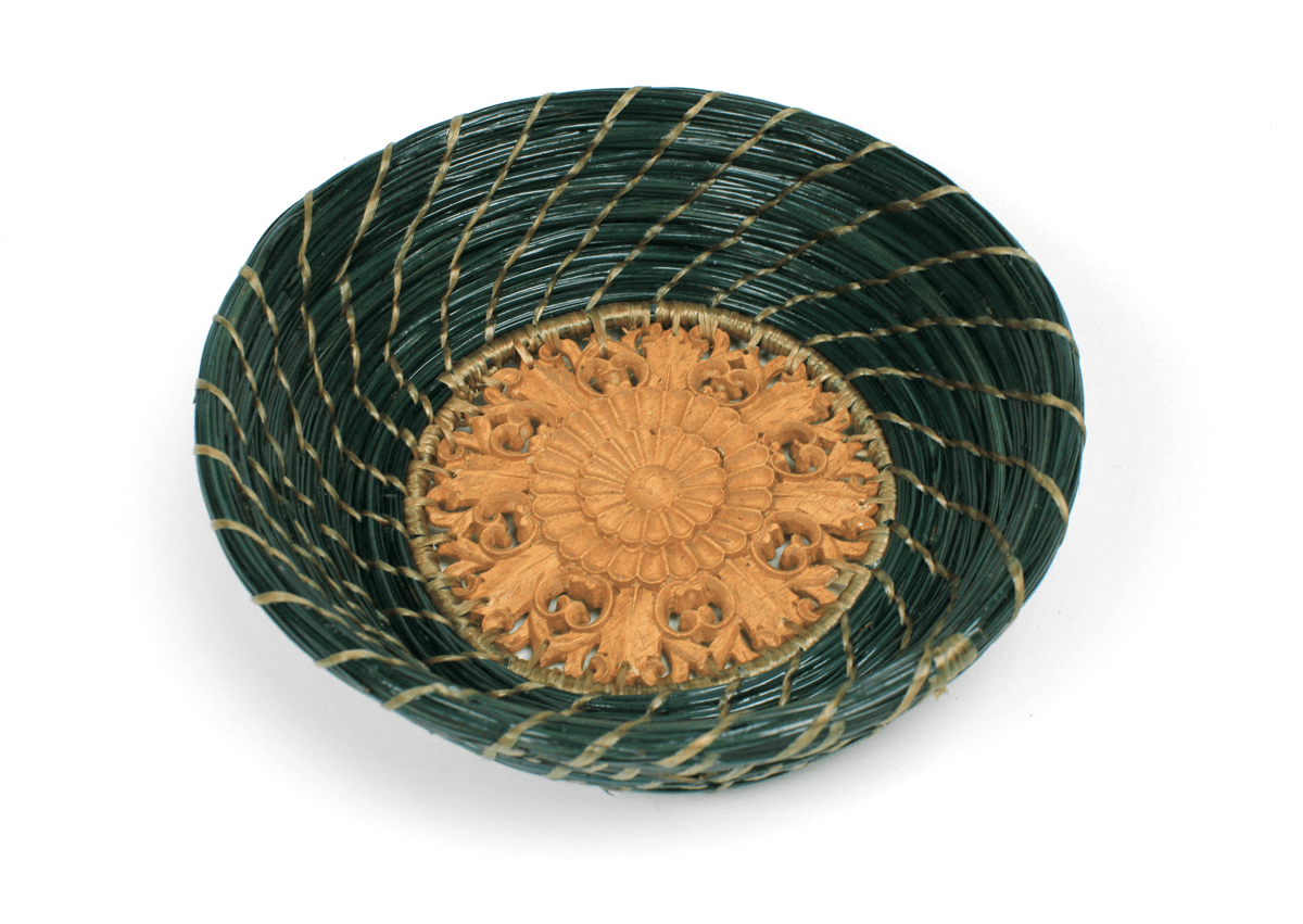 Green hand-woven pine straw basket